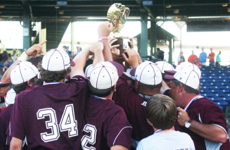 The Kossuth Aggies hold up the Golden Glove after their Class 3A State Title win over Sumrall High School.